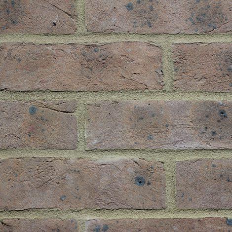 Grey Brown handmade brick in a wall setting