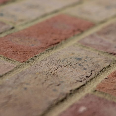 Multi handmade brick shot along the brick to show texture