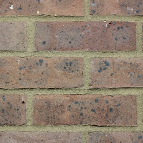 Grey Brown machine made brick in a wall setting