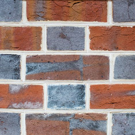 Stuart style woodfired brickwork with white pencilling on ruled joint profile - front view