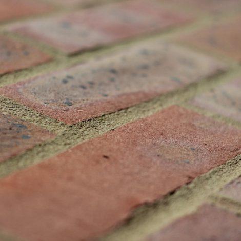 Multi machine made bricks shot along the brick to show texture
