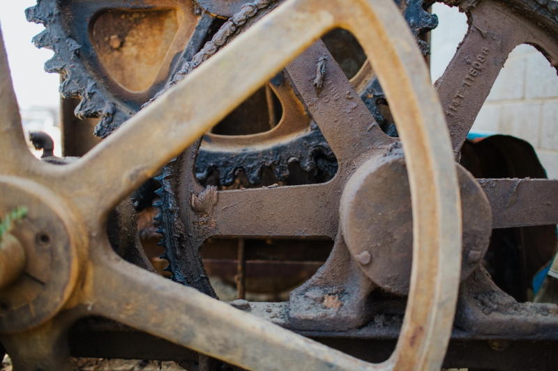 Wheels and cogs on the machinery used to make the earth blocks in our new build systems