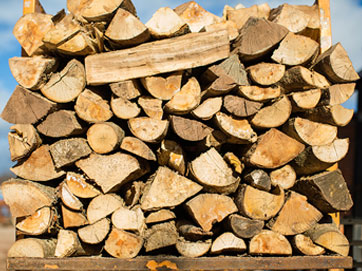 Stack of wood ready to be used in the woodfired kiln as part of our consideration to the environment