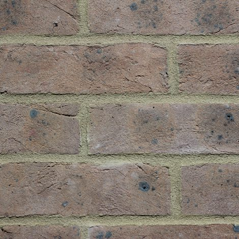 Grey Brown handmade brick in a wall setting