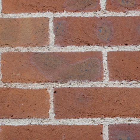 Light Multi handmade brick in a wall setting