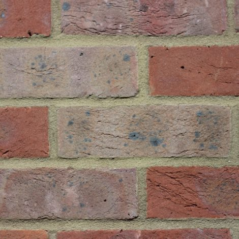 Multi handmade brick in a wall setting