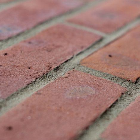 Light Multi machine made brick shot along the brick to show texture