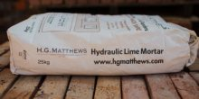 Bag of HG Matthews hydraulic lime mortar on a wooden pallent